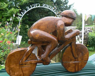 Wooden Cyclist in Hardwood at Greystoke Cycle Cafe with Alister Neville -carved by the tutor!